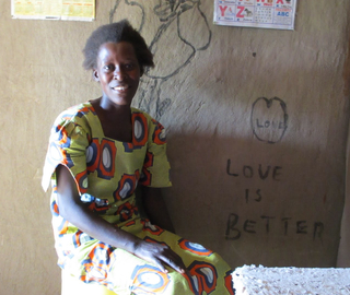 A GiveDirectly cash transfer recipient in her home. (Photo courtesy of GiveWell)